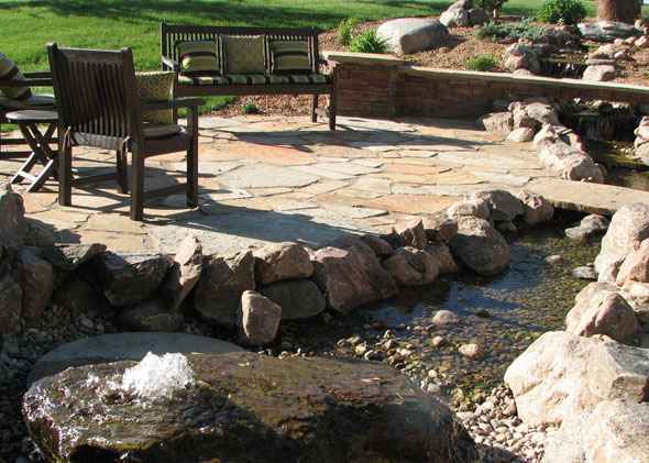 Patio with fountain and creek