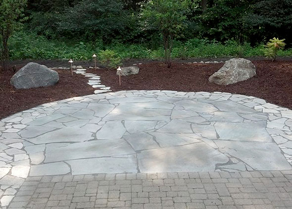 Cobblestone parking area in front of house